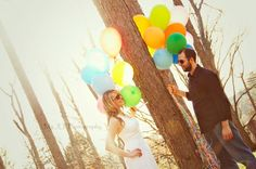 I decided to do a Trash the Dress session, but made it more a Rock the Dress session because I couldn't bear to ruin my gown. My husband and I love the movie, Up, and he always says we are Carl and Ellie. So, we decided to use two dozen bouquets of balloons for several photos. Our photographer had great ideas for them! Credit: My JLP Photography