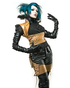 Zoetica Ebb  This isn't quite steampunk, nor is it truly goth...I don't know what it is, but I like the brown harness/holster-esk combo. #steampunk #punk #goth #gothic #hair #woman #fashion #leather #harness #buckles #straps #holster