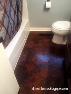 My beautiful, affordable, durable paper bag floors!!!  A DIY bathroom floor tutorial...  (lil-red-house.blogspot.com)  Did this many years ago with 3 coats of poly and no stain.  It wore extremely well, not affected by liquid floor cleaners.