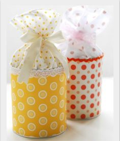 Empty baby formula containers upcycled into pretty goodies/cookies packaging.