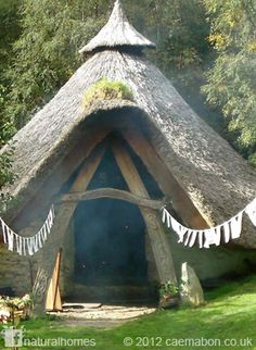 This beautiful thatched roundhouse is the centrepiece of Cae Mabon, the storytelling room. Cae Mabon was created over the last twenty or so years by storyteller, songwriter and author of children's picture books, Eric Madern. More pictures at www.naturalhomes.org/caemabon.htm