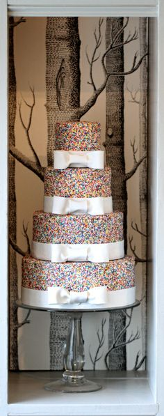 I stole this from my friend Jessica and her oh-so-adorable blog, Storyboard Wedding. This cake perfectly describes me from childhood to adulthood. I am and always have been obsessed with sprinkles and Im not afraid to admit it!