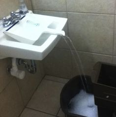 Use a dustpan to fill buckets that are too big to fit in the sink.
