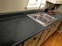 How to Paint Laminate Kitchen Countertops from DIYnetwork.com