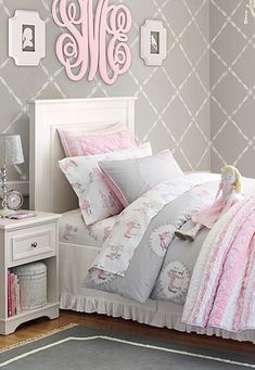 Absolutely loving this pink and gray palette, this wallpaper and the darling monogram above the bed!