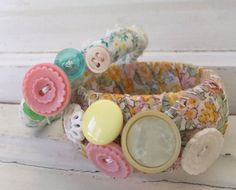 Fabric covered bracelets, embellished with buttons!