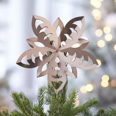 This origami-inspired metal snowflake tree topper is so beautiful & sophisticated!