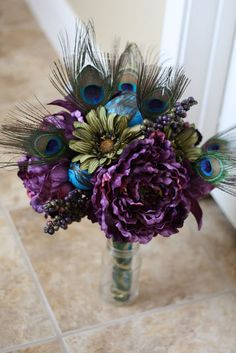 Purple, Turquoise & Green theme wedding + peacock feathers  #peacock #wedding #bouquet