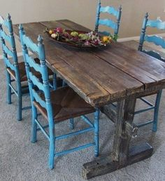 this could totally be my kitchen--I love the bright paint on the chairs and the rustic, reclaimed look of the table. It's so warm and inviting.