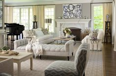 Use a daybed as a room divider. In a really large living room, you may wish to create two full seating areas. Mark the separation while keeping the flow between the two zones with furniture you can easily see over: a daybed, bench, or chaise is a good option.