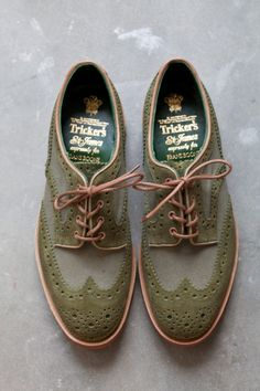 Green and grey, alternating leather and canvas fabric wingtips with tan piping, leather, and outsoles.