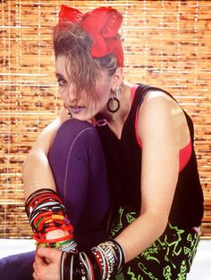 Madonna in 1984 - with big, Minnie Mouse style bow, tonnes of bracelets, and strappy vest: screaming 1980s cool! #PINSuperdrug50