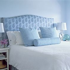 A plush headboard in Kashmir Paisley fabric by Peter Dunham and linens by Serena & Lily create a serene sleeping environment in this California Cottage. | Photo: Lisa Romerein | thisoldhouse.com bedroom interior design, blue california, headboard, california cottag, coastal live, hous, cottages, cottage master bedrooms, bedroom interiors