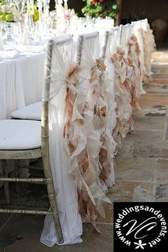 These wedding chair sashes were made from a sheer chiavari chair cover with various ribbon tie.