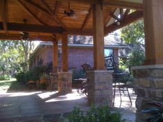 Cedar columns with stone base and cedar ceiling finishes on freestanding cover in Richmond by TexasCustomPatios, via Flickr