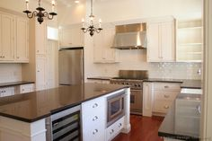 #Kitchen Idea of the Day: A gallery of classic white kitchens. Nice island chandeliers.