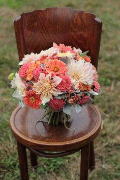coral and blush bridal bouquet with zinnias and dahlias
