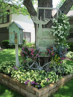 Vintage Summer Garden - I used another old vintage potting shed door and hung it on my tree. The birdhouse is also sitting on an old chippy post. The old metal bike is another fun way to put potted plants in the garden.