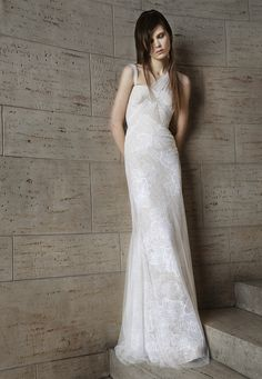 Look 7. Ivory and nude hand draped tulle soft mermaid gown with hand appliqué Chantilly lace skirt accented by tulle overlay.