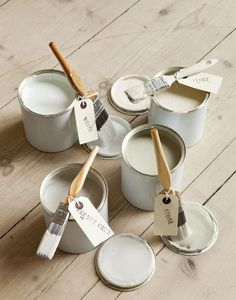 shades of white and pale raw wood for floors,furniture.