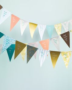 This paper flag banner doubles as decor and escort cards.