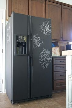 this sweet fridge is covered in chalk paint so you can draw on it!just like on Good Luck Charlie;)