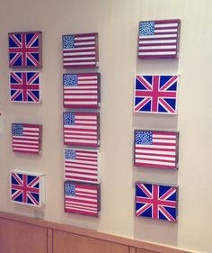 Original work by San Mateo artist Emily Smith- flags on rustic recycled wood. At San Mateo HOME Department!