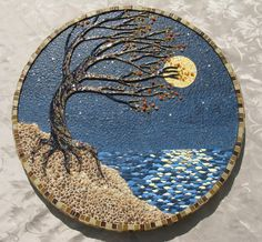 A tree,blowing in the wind and clinging to a cliffside. Mixed media, eggshell, sead and bugle beads, pebbles, polymer clay, glass tile. Inspiration - #EggshellMosaic †å