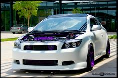 Scion Tc with purple rims and matching engine bay