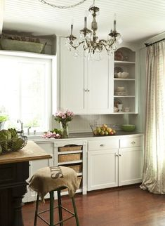 FRENCH COUNTRY COTTAGE: French Cottage Kitchen I like the baskets in the kitchen cupboard