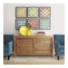 i love these for the family room, though i am pretty sure i can do them for much less than $369. ikea 12 x 12 frames, metalic paint, fun stencils, and we're golden.