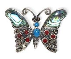$29.19  Marcasite brooch casted in Sterling Silver features a butterfly with Mother of Pearl, reconstituted Turquoise & simulated Coral Inlay. Pin will be shipped in a FREE gift box making it easy for you to surprise your special someone. Thank you for shopping at Gem Avenue!