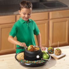 The Caramel Apple Maker ♥ This tabletop appliance makes it easy to create sticky sweet candy apples without the hassle and mess of melting caramel on a stove top.  The stainless steel melting pot is heated by an electric heating element instead of a stove, so it is safe and easy to use with children.
