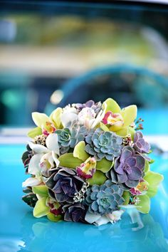 Bright succulent and orchid bouquet   Photo: Clau Photography