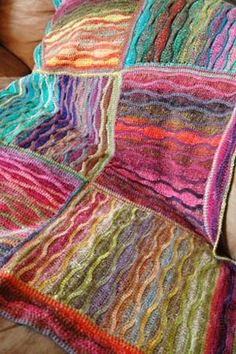 Chameleon baby blanket. Very unusual. May try it sometime. Free Pattern.