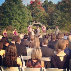 Ceremony at the Barn with the treeline as the backdrop.