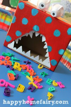 """Small group activity...A creative idea to teach alphabets to your kids without them knowing! Ask them to feed the monster an """"a"""" if they put in the wrong letter shake it around ad have him spit it back out then ask them to try again"""