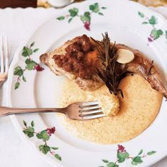 This rabbit dish is braised in Oregon Pinot Gris and rosemary with gorgonzola polenta.