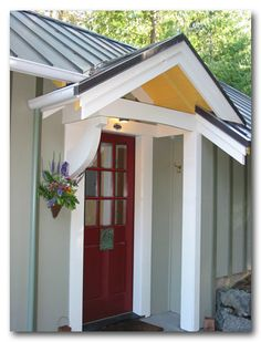 I'm loving the white woodwork of the porch contrasted with the painted siding.