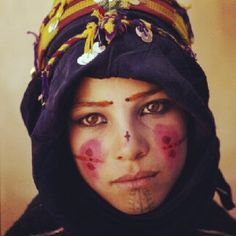 Amazing girl from the Atlas Mountains of Morocco. Beautiful woman, beautiful tattoos and body paint.