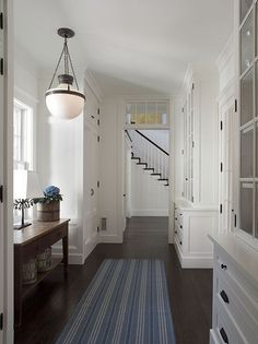 beautiful hallway floors built ins