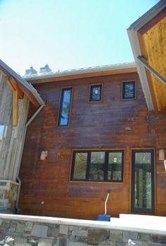 Finished flat sheets of rusty steel siding.  Ohhhhh I love!    http://www.cortenroofing.com/Images/46_lrg.jpg