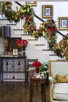 Love the staircase garland and bows on the moss ball topiaries