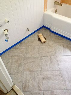 Peel and stick tiles with grout, looks like ceramic.