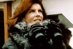 Rene Russo's jetset style in The Thomas Crown Affair (study every one of her classic looks)