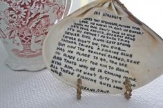quote written on a seashell found on a beach with date & location written on it.