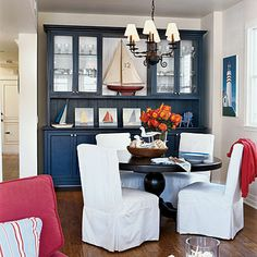 Nautical Dining Room: The family's dining room also features nautical elements and a patriotic color palette of red, white, and blue. The homeowners designed the hutch and table, along with other furnishings, to fit the space and their needs.