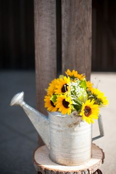Watering Can Vase For Wedding decor, idea, watering can wedding, sunflower vase, barn weddings, watering cans, rustic weddings, barns, sunflower rustic wedding