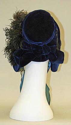 Bonnet 1861, American, Made of silk and ostrich feathers ~~~~~ The look of demure prim gentility was emphasized by the loss of the great hats in 1835 for bonnets. Great hats had given a flirtatious air to clothes and their replacement by bonnets changed the whole character of day dresses. Lavishly trimmed bonnets stayed in fashion for half a century and weren't worn much after 1890.