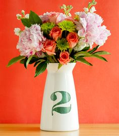 #DIY Table Number Vase   Confetti Pop - This centerpiece is a sophisticated #wedding two-fer.